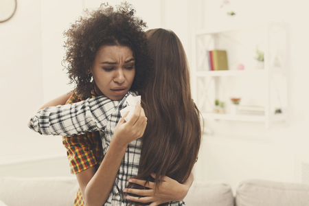 Woman Hugging Mourning Friend